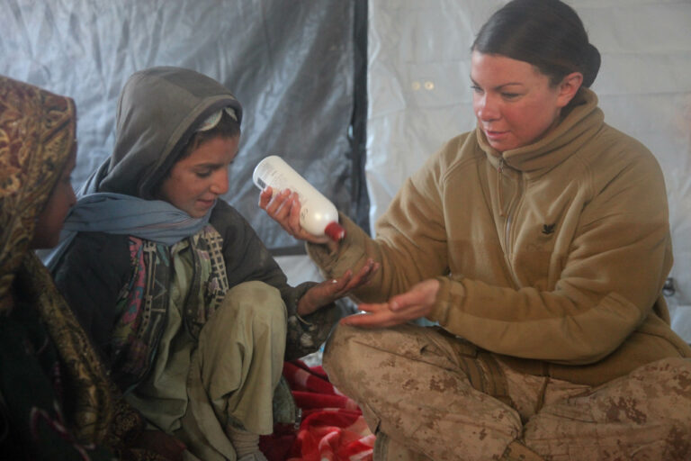 Hospital Corpsman 3rd Class gives basic hygiene class during health initiative in Sangin, Afghanistan
